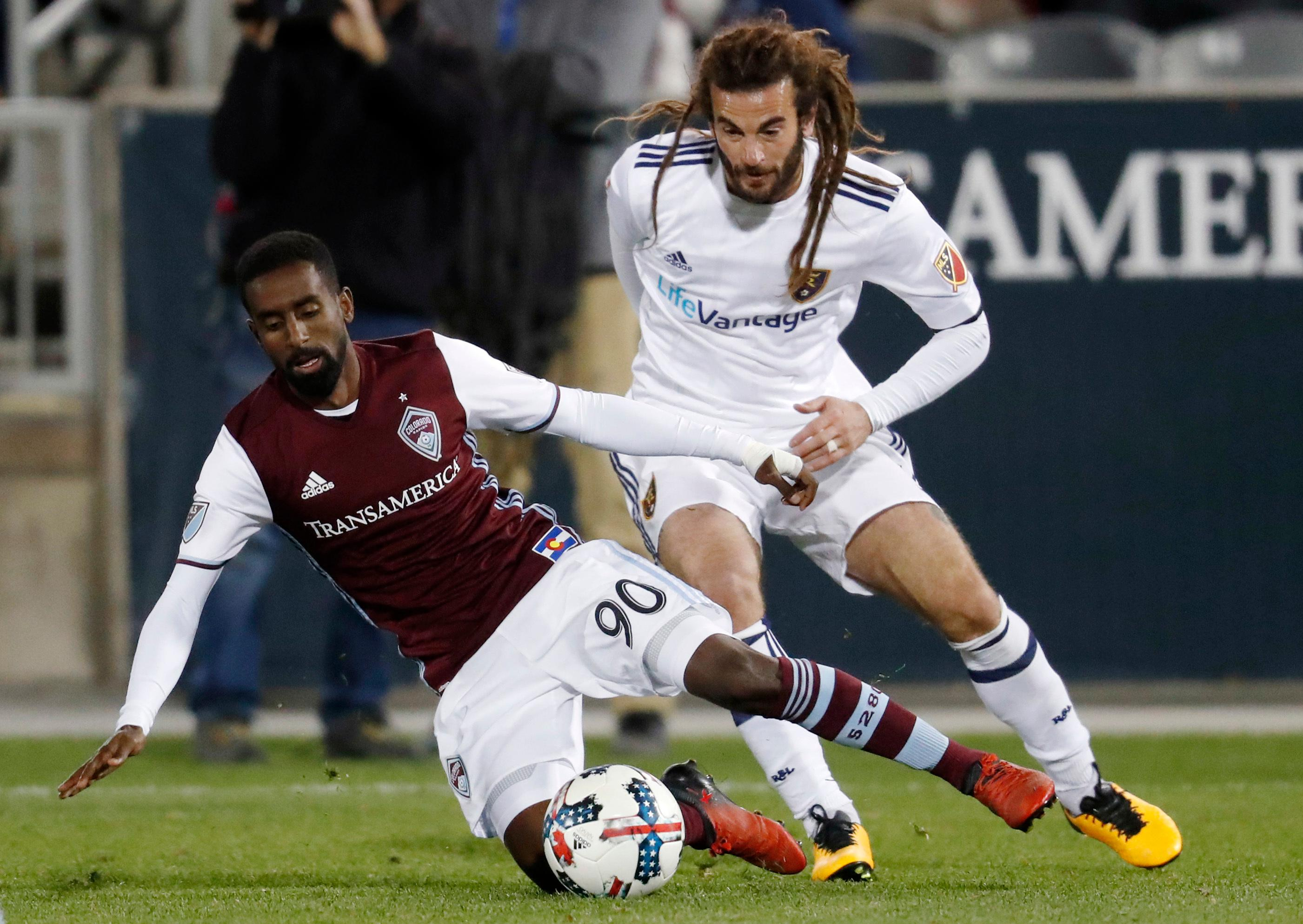 Colorado Rapids midfielder Mohammed Saeid, left, fights for control of the ball with Real Salt Lake midfielder Kyle Beckerman in the second half of an MLS soccer match, Sunday, Oct. 15, 2017, in Commerce City, Colo. The Rapids won 1-0. (AP Photo/David Zalubowski)