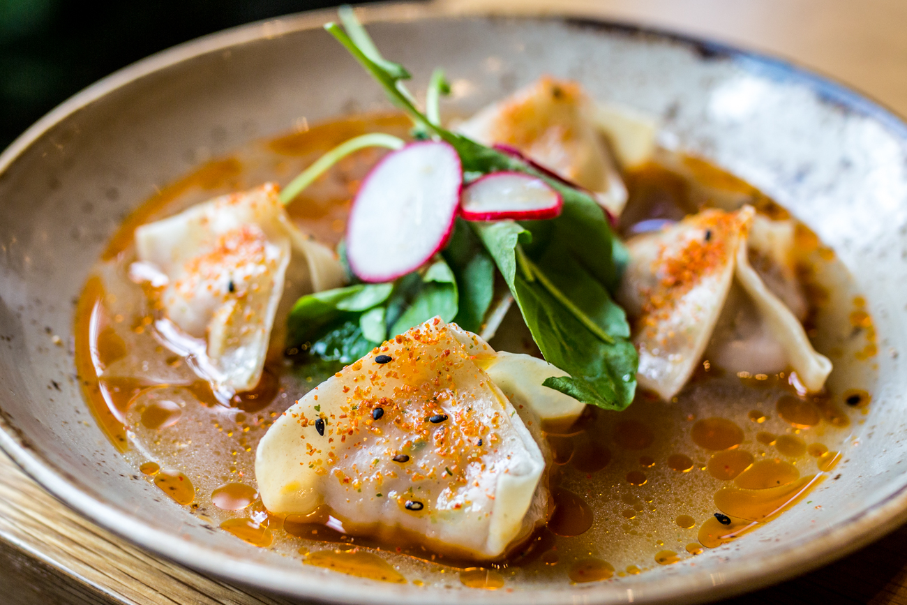 Chicken Ginger Dumplings: steamed chicken dumplings, watercress, radish, lemongrass, and chicken broth / Image: Catherine Viox{ }// Published: 9.9.19