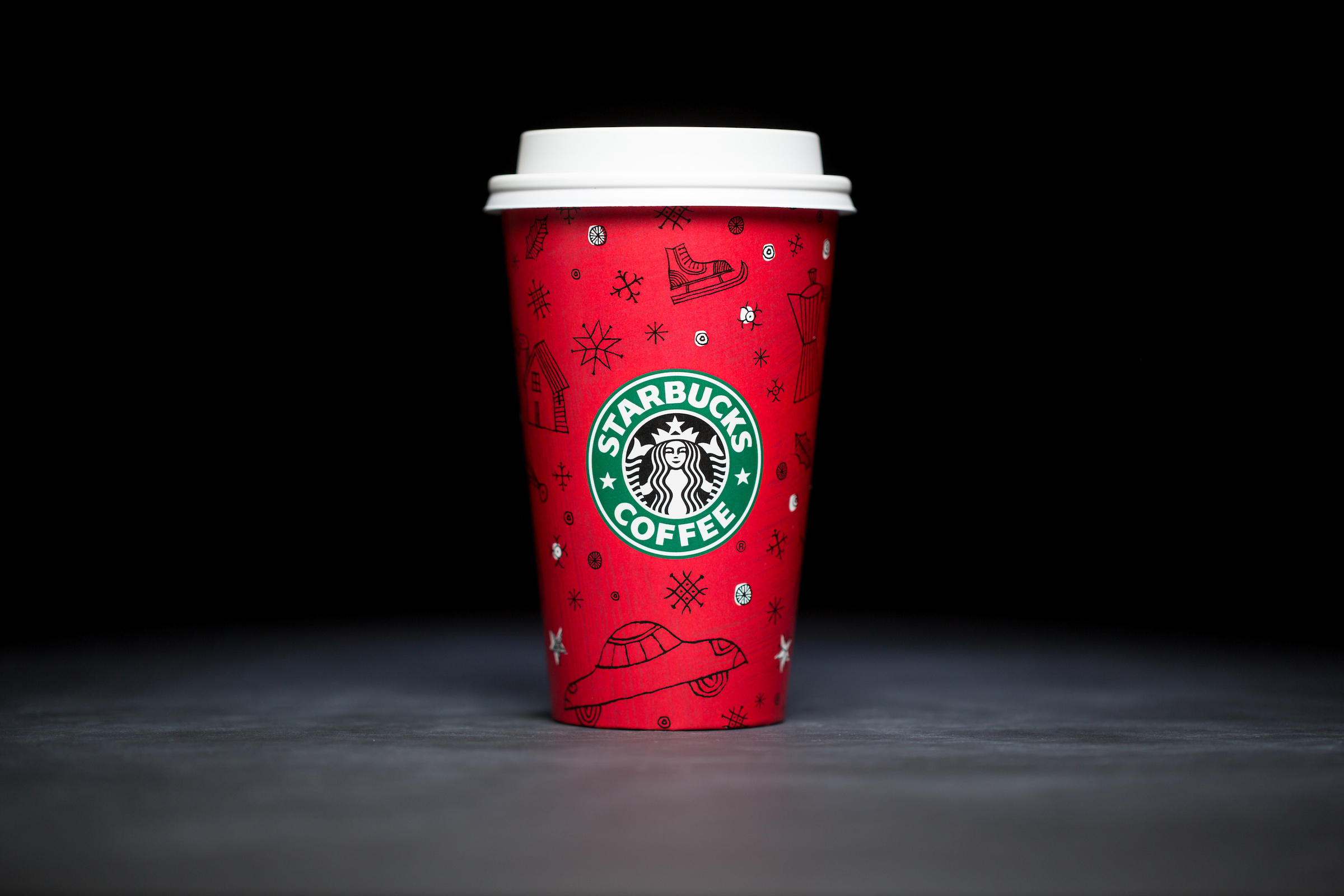 1999: For 20 years, Starbucks have released a range of holiday cup designs, most of them based around their world famous red cup. It's not easy to find the very first Starbucks holiday cups, which made their debut in stores in 1997. Few were saved, and electronic design files were lost in an earthquake in 2001. Even an Internet search is unyielding, with the cups having made their arrival long before the first selfie. But, we have them here! Click on for a photos of all 20 holidays cup designs. (Image: Joshua Trujillo/Cover Images)