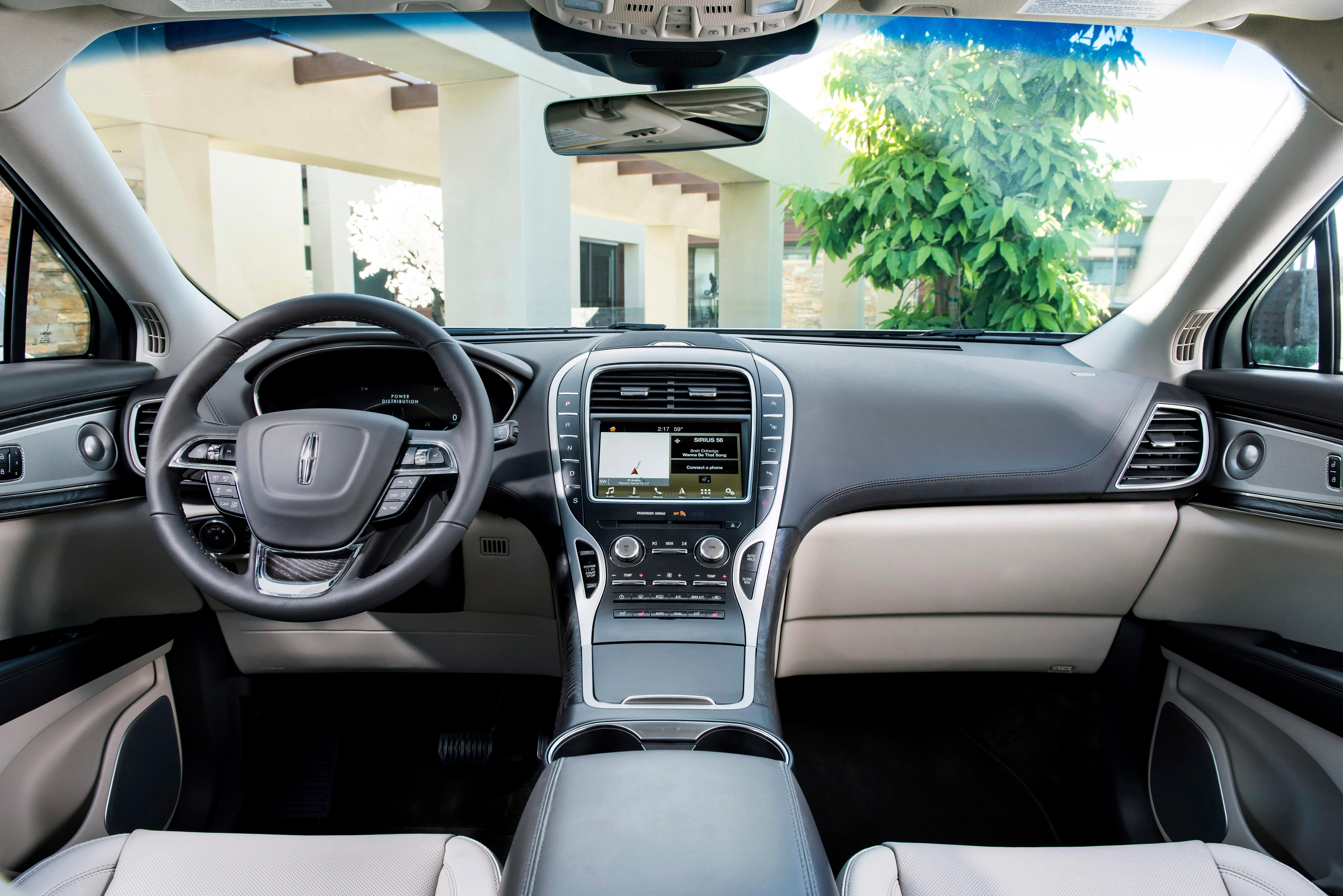This photo provided by Ford Motor Co. shows the interior of the 2019 Lincoln Nautilus. The 2019 Nautilus swaps its V6 engine for two turbocharged four-cylinder choices. (James Lipman/Ford Motor Co. via AP)