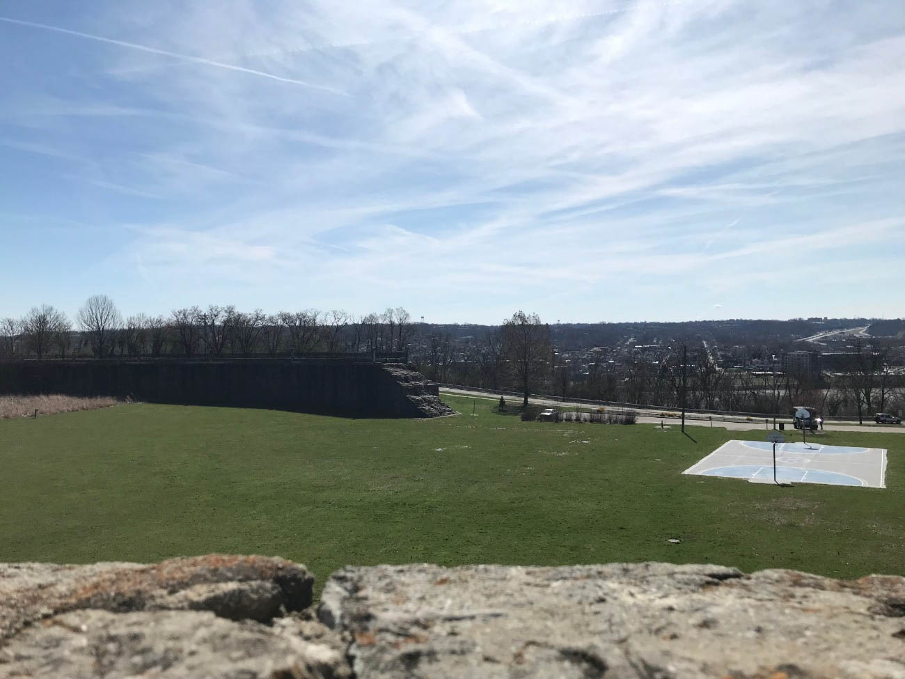 All that resides in the lower basin are the remnants of the retaining walls and a lonely basketball court in the wide-open field. The sloping ravine is a popular sledding hill in the winter months. / Image: Amy Bauer // Published: 4.12.19