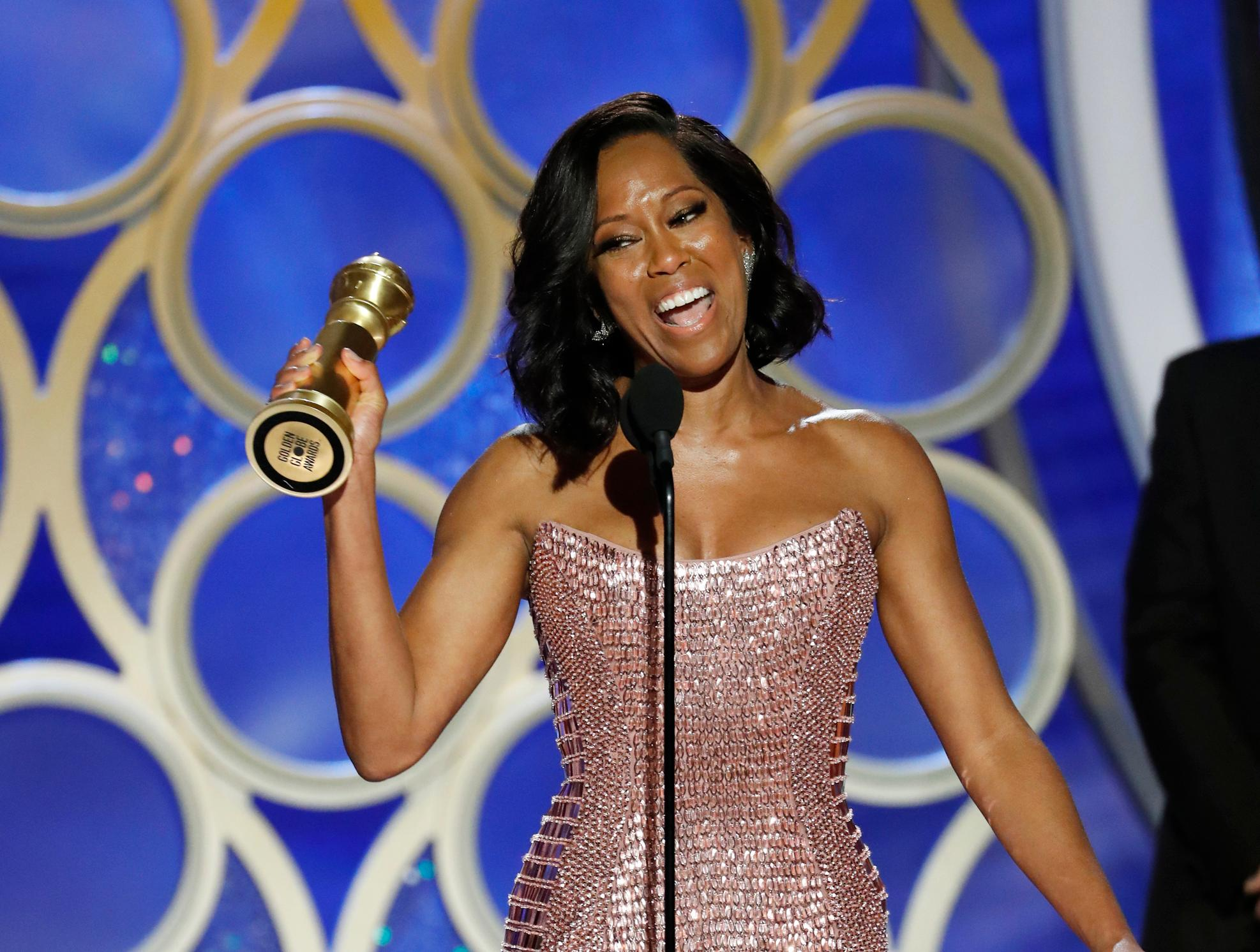 "This image released by NBC shows Regina King accepting the award for best supporting actress in a motion picture for her role in ""If Beale Street Could Talk"" during the 76th Annual Golden Globe Awards at the Beverly Hilton Hotel on Sunday, Jan. 6, 2019 in Beverly Hills, Calif. (Paul Drinkwater/NBC via AP)"