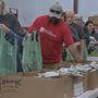Volunteers pack over 6,000 food kits for elementary kids