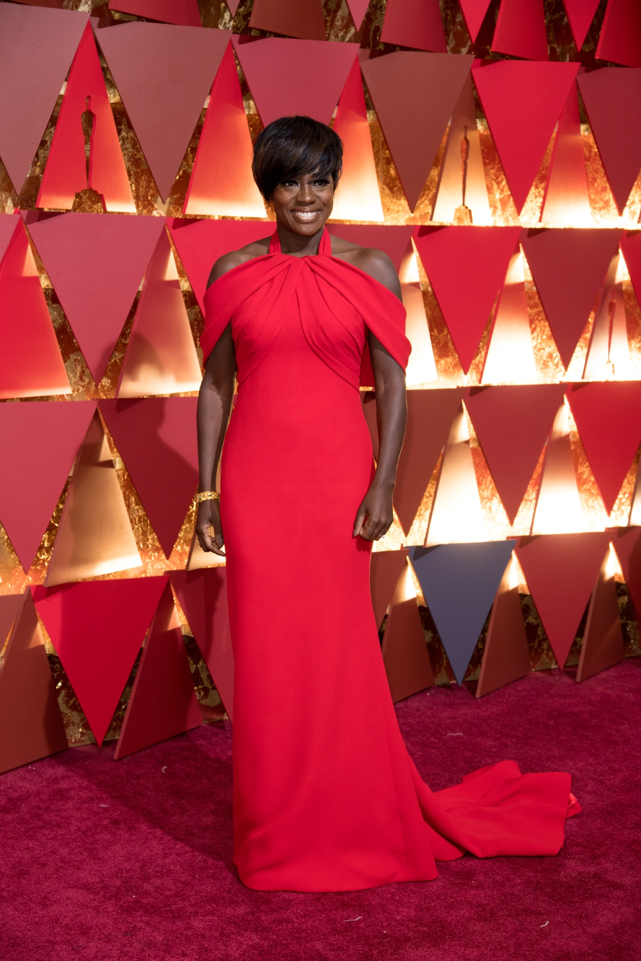 #9: Viola Davis. It seems like everything Viola does is amazing, and that includes her getting ready tonight. That color on her, and the peekaboo shoulders is giving us live. (Image: AMPAS)