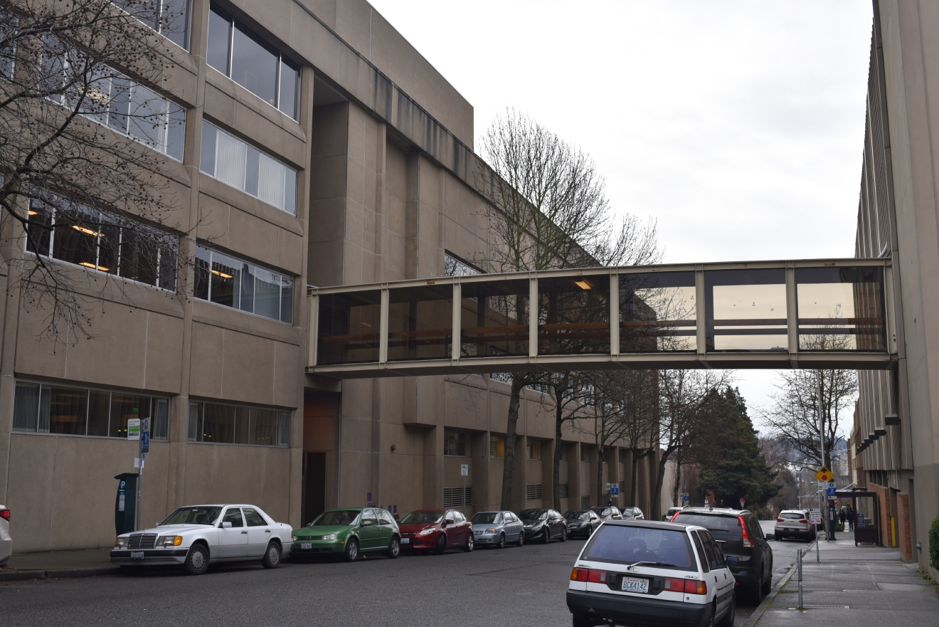 The skybridge linking the UW Tower building with the parking garage is tucked away on 12th Avenue NE just off NE 45th Street. The basic skybridge provides ADA accessibility in a congested part of town. (Image: Rebecca Mongrain/Seattle Refined)