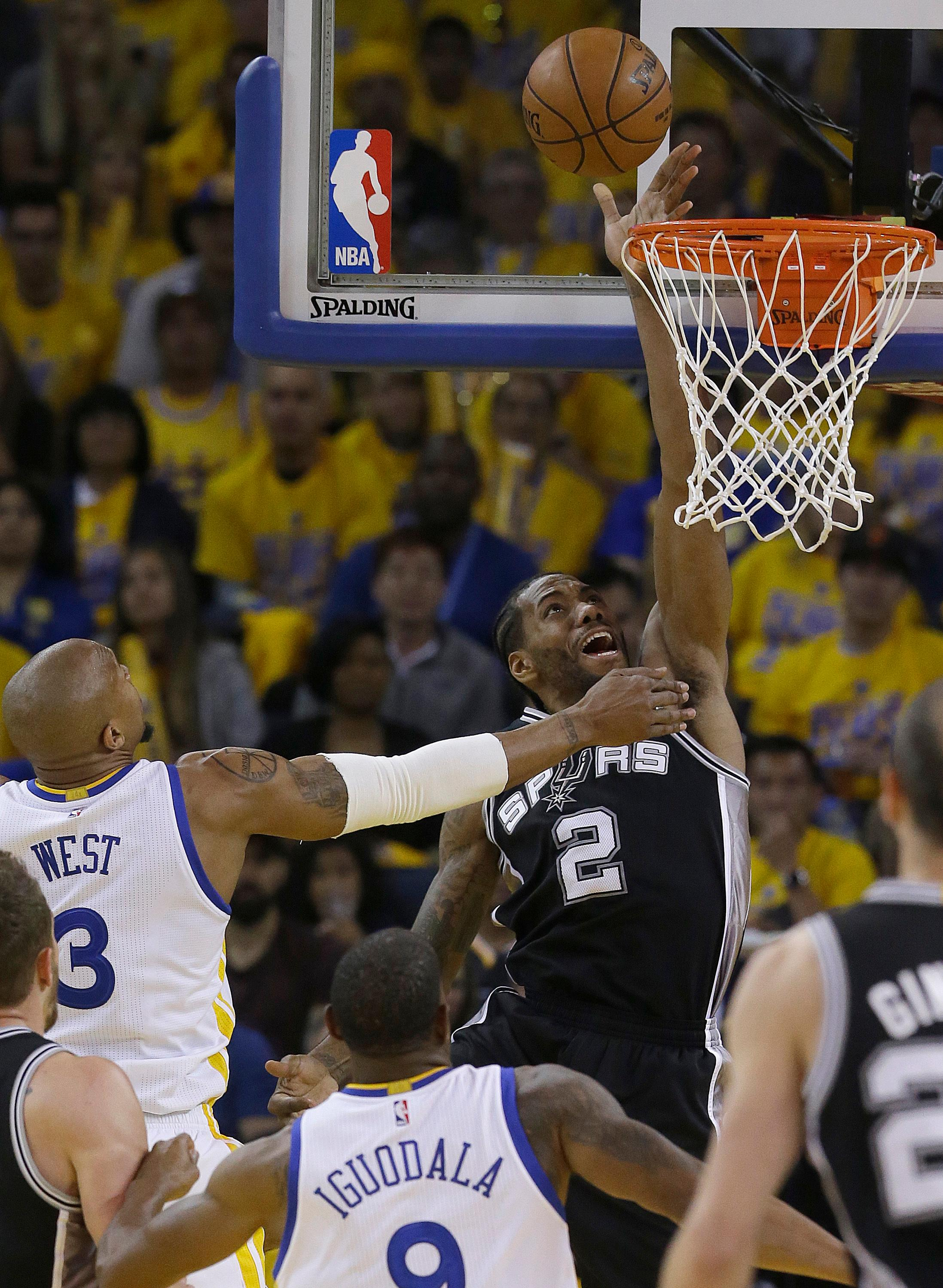 San Antonio Spurs forward Kawhi Leonard (2) scores against the Golden State Warriors during the first half of Game 1 of the NBA basketball Western Conference finals in Oakland, Calif., Sunday, May 14, 2017. (AP Photo/Jeff Chiu)