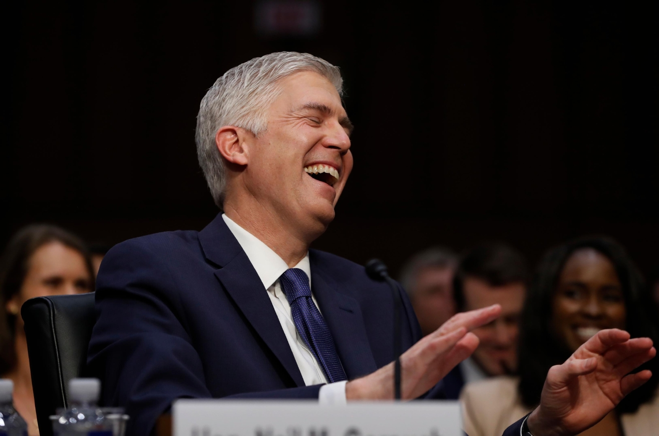Supreme Court Justice nominee Neil Gorsuch laughs on Capitol Hill in Washington, Monday, March 20, 2017, during his confirmation hearing before the Senate Judiciary Committee. (AP Photo/Pablo Martinez Monsivais)