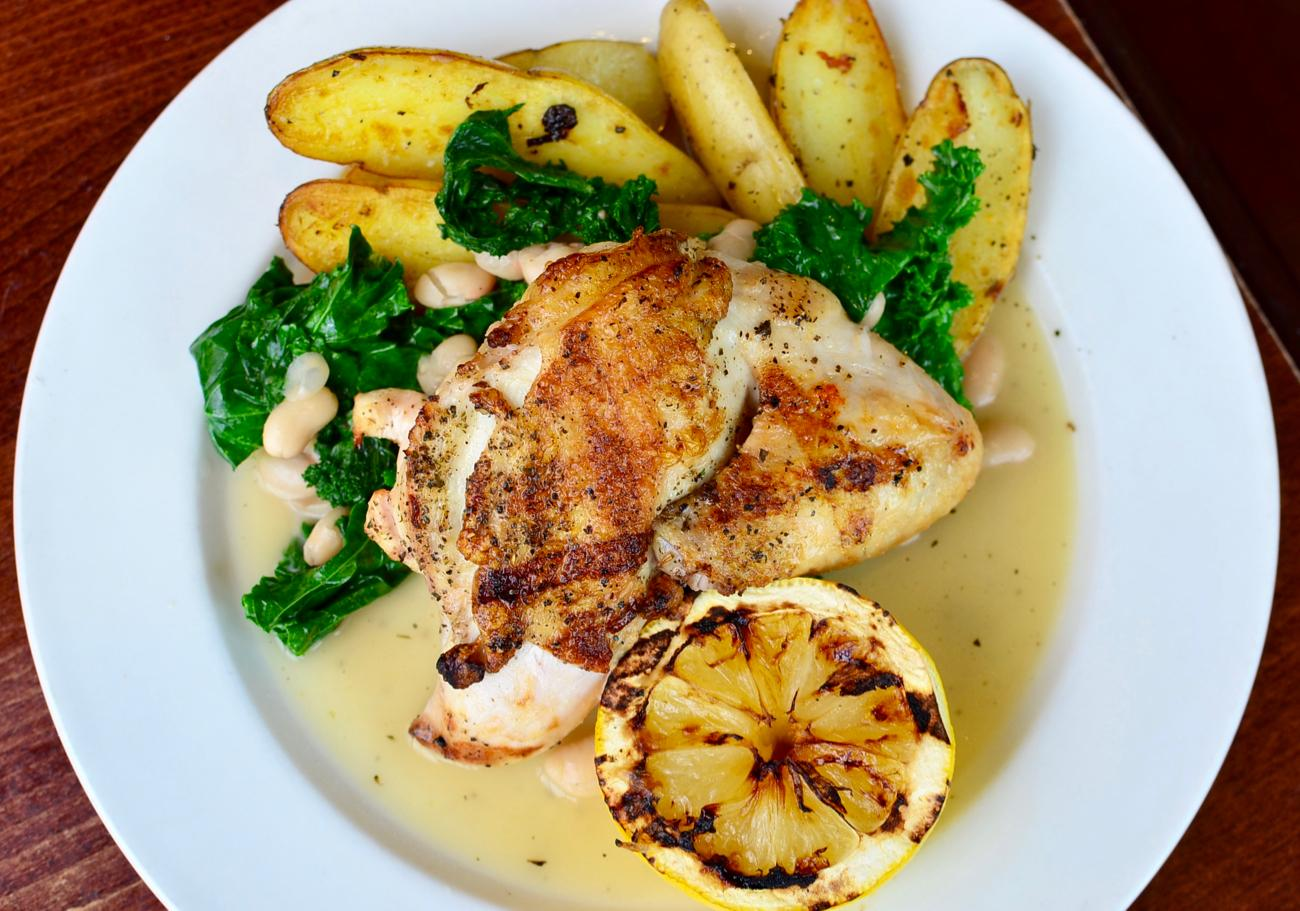 Airline Chicken: grilled breast with wing brined in lemon and garlic, roasted fingerling potatoes, cannellini beans, braised greens / Image: Leah Zipperstein, Cincinnati Refined // Published: 9.4.17