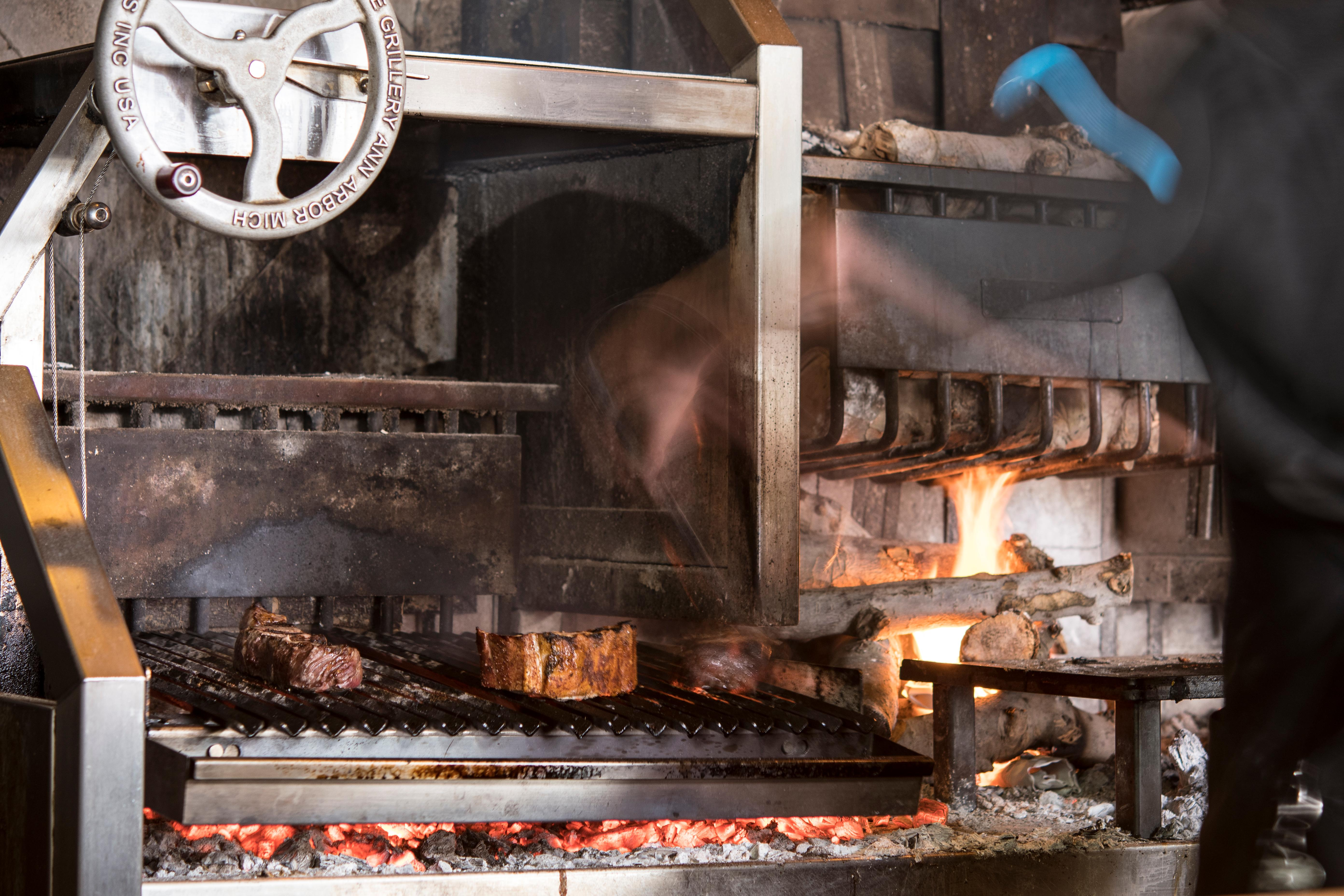 Steaks on the grill at Miller's Guild. (Image: Fire & Vine Hospitality)