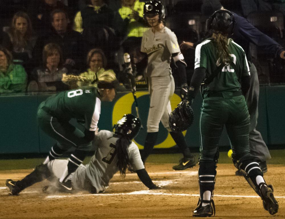 Oregon Ducks Cherish Burks (#31) colides at home plate with Portland State Elena Cook (#8) to give the ducks to an 8-0 lead that would lead to another home win for the Ducks. The Ducks are now 35-0 this season matching a NCAA record for most consecutive wins to start a season, winning the first game 3-1 then following up with a 8-0 win in the second and will next play UCLA on April 7th in Los Angeles, California. Photo by Jonathan Booker, Oregon News Lab
