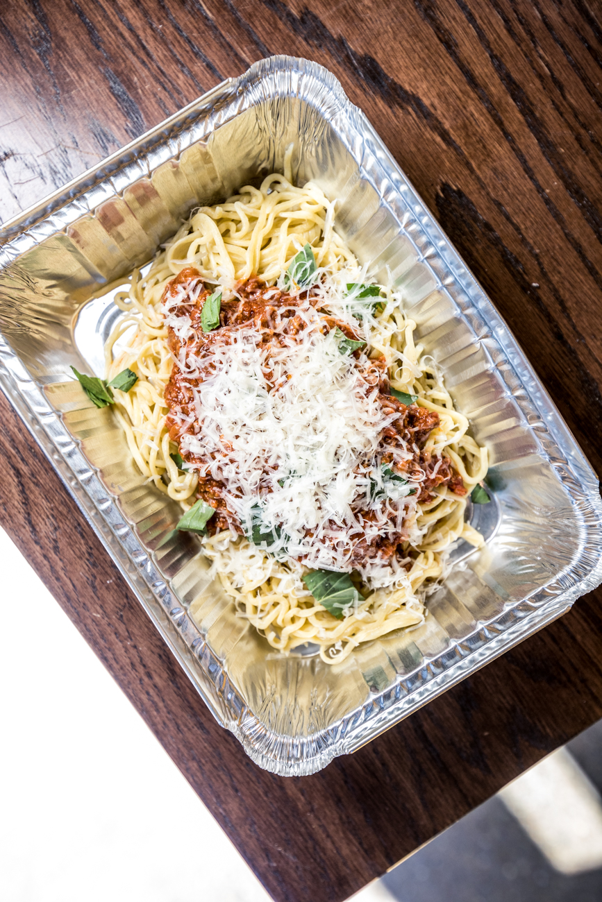 Spaghetti and Meat Sauce: house-made pasta, Italian sausage meat sauce, Parmesan, and basil / Image: Catherine Viox{ }// Published: 5.16.20