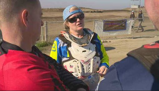 Ginny Hopper talking to fellow The Valley Over The Hill Gang members before the race. (FOX26)<p></p>