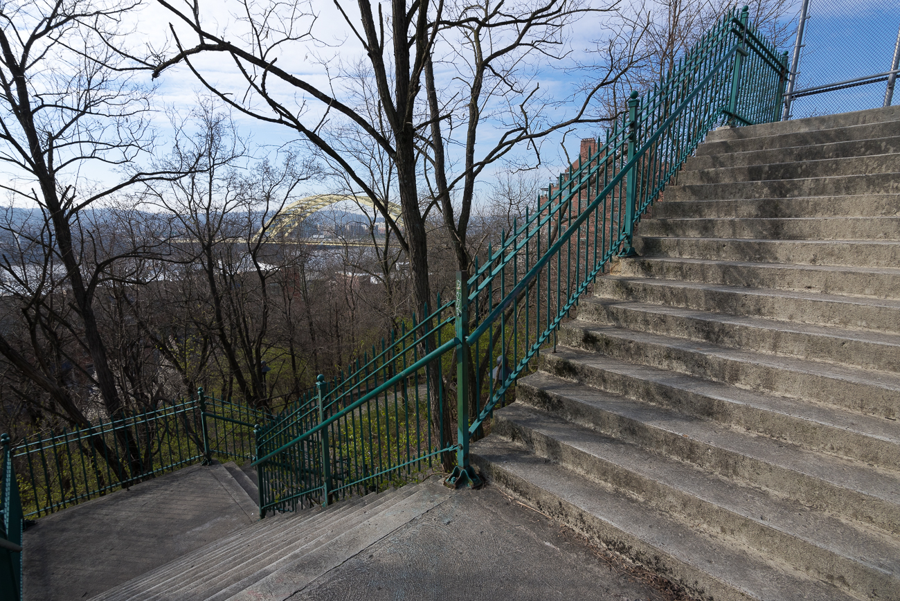 The stairs climb upward near the top of the hill to connect to a pedestrian bridge over Columbia{ }Parkway. / Image: Phil Armstrong, Cincinnati Refined // Published: 4.13.18