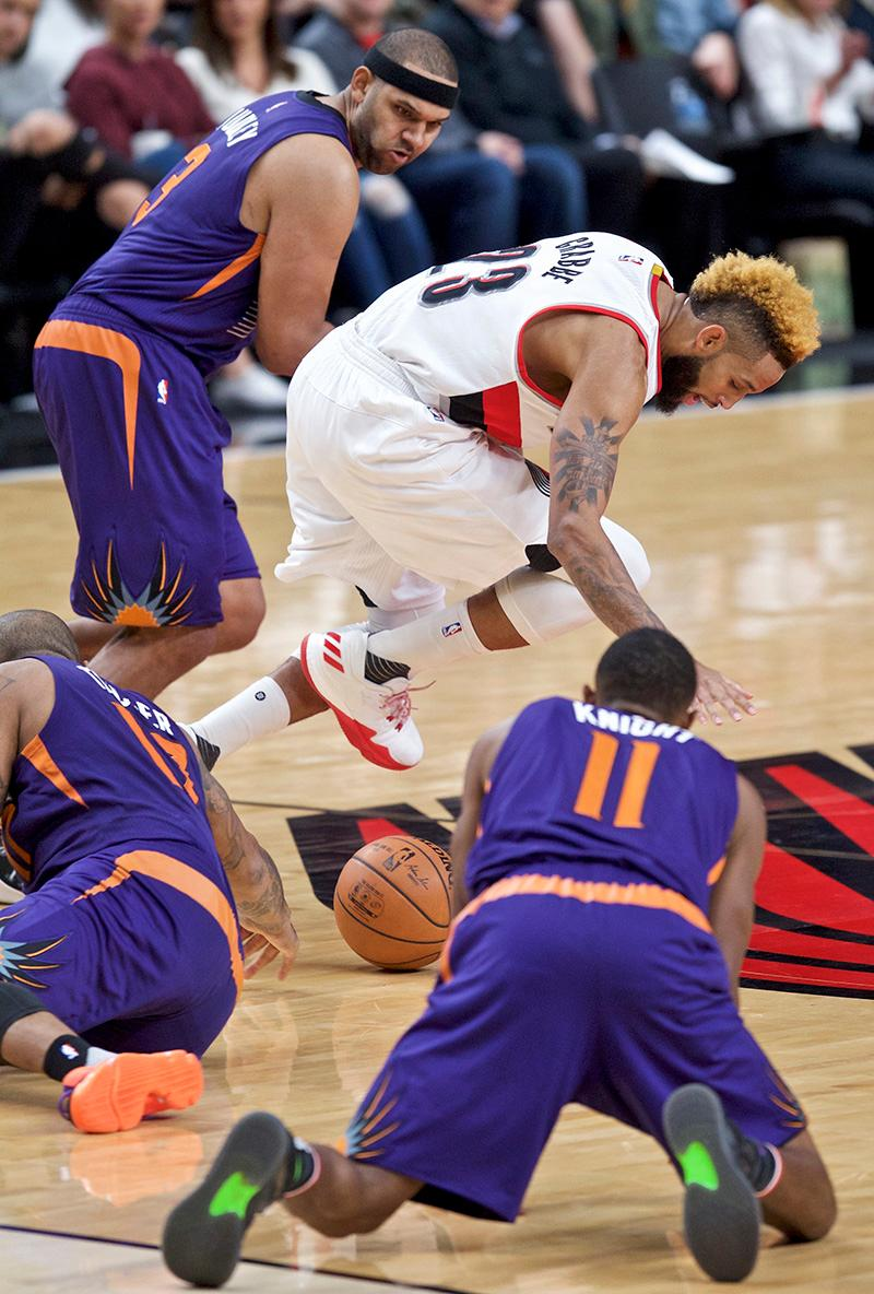 Portland Trail Blazers guard Allen Crabbe, middle, gathers a loose ball in front of Phoenix Suns forward Jared Dudley, back left, during the second half of an NBA basketball game in Portland, Ore., Tuesday, Nov. 8, 2016. Suns' Brandon Knight is at lower right. (AP Photo/Craig Mitchelldyer)