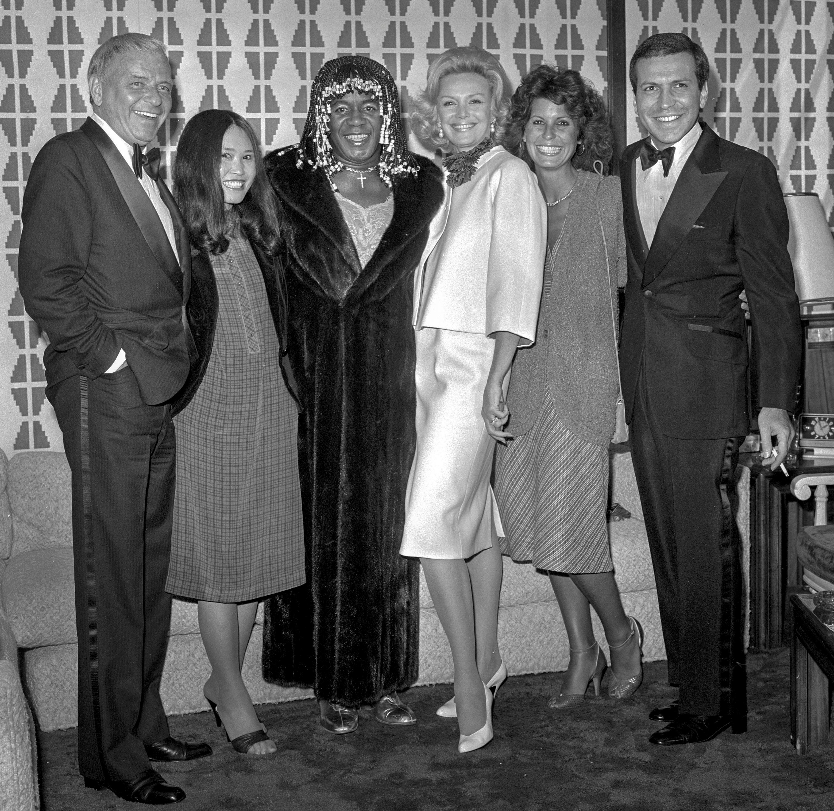 From left, Frank Sinatra, unknown, Flip Wilson, Barbara Sinatra, Tina Sinatra and Frank Sinatra Jr. are seen July 27, 1980 at the Sahara in Las Vegas. CREDIT: Las Vegas News Bureau