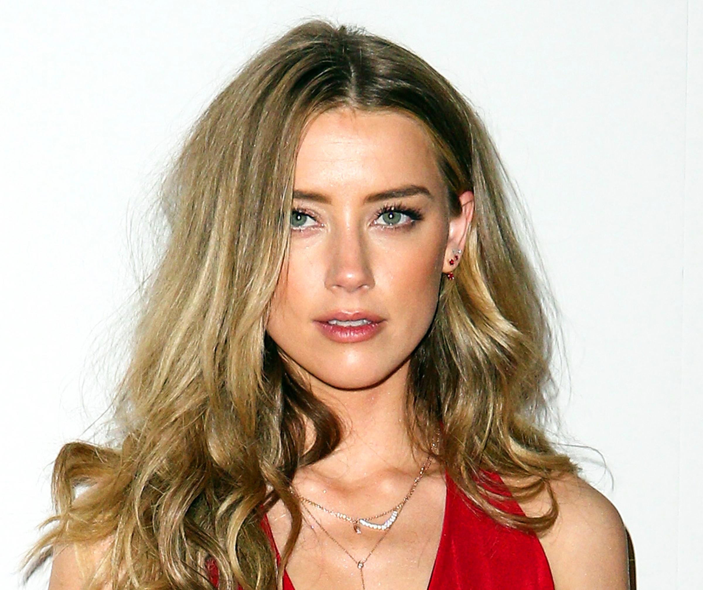 "FILE - In this April 12, 2016, file photo, Amber Heard attends the LA Premiere of ""The Adderall Diaries"" in Los Angeles. Heard and ""Aquaman"" director James Wan shared pictures of Heard in character as Aquaman's love interest Mera on Thursday, May 18, 2017. ""Aquaman"" is currently filming in Australia. (Photo by John Salangsang/Invision/AP, File)"