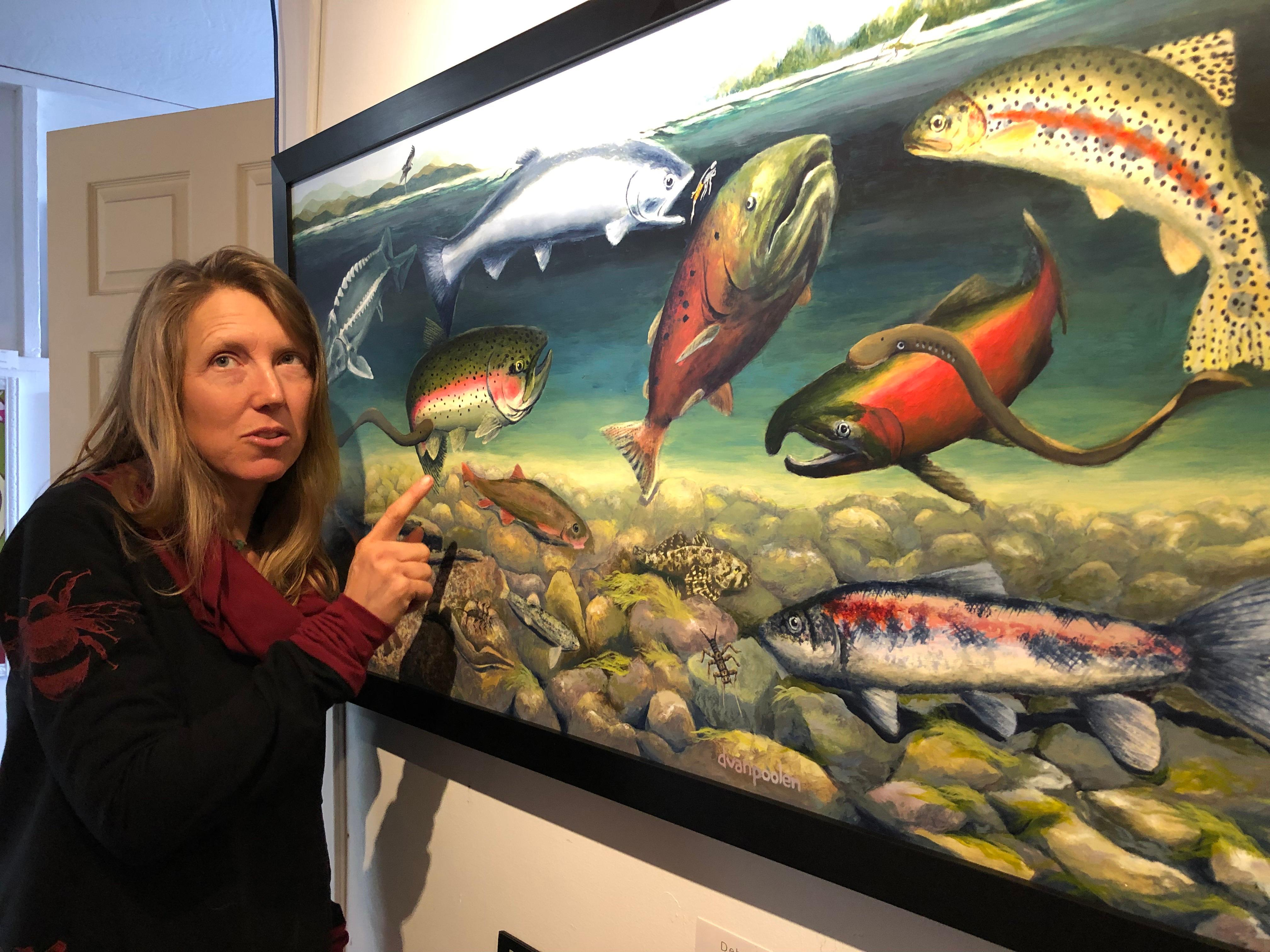 Ashland artist Deb Van Poolen with artwork she created that's featured in the Klamath River Fishes poster. Photo by John Darling
