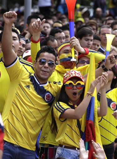 Colombia soccer fans cheer during their team's World Cup game against Greece in Bogota, Colombia, Saturday, June 14, 2014. Colombia defeated Greece 3-0.
