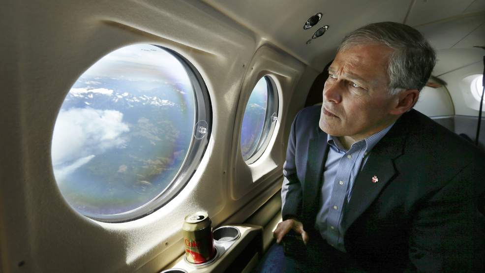 Jay inslee file wildfires fly over AP19060080442801.jpg