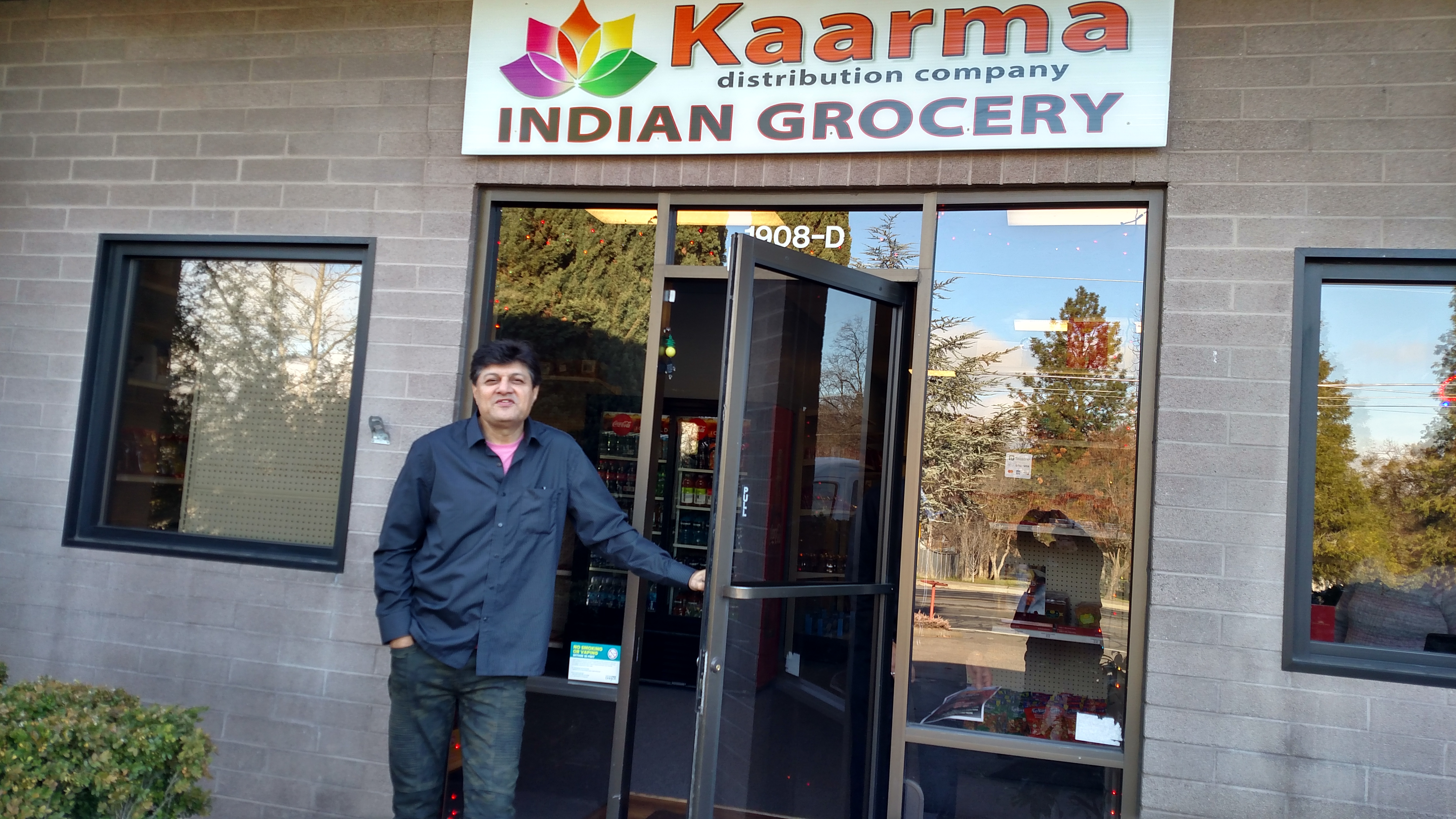 Sumesh Bakshi in the doorway of his new store, Kaarma Indian Grocery at 1908 Ashland St. in Ashland. Photo by Maureen Flanagan Battistella<p></p>