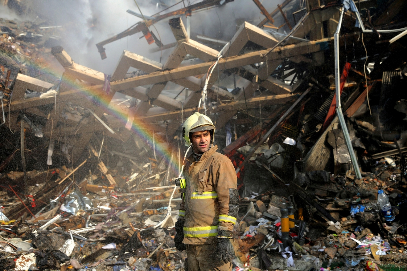 Rigopiano hotel avalanche first funerals as search goes on bbc news - A Rainbow Appears As A Firefighter Removes Debris Of The Plasco Building Which Was Engulfed By