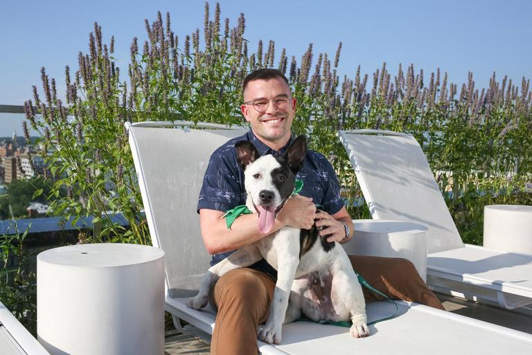 Meet Nate and Wesley, a 6-month-old Great Dane/Akita mix and a 35-year-old human respectively.{ }Photo location: 880 P apartments (Image: Amanda Andrade-Rhoades/ DC Refined)