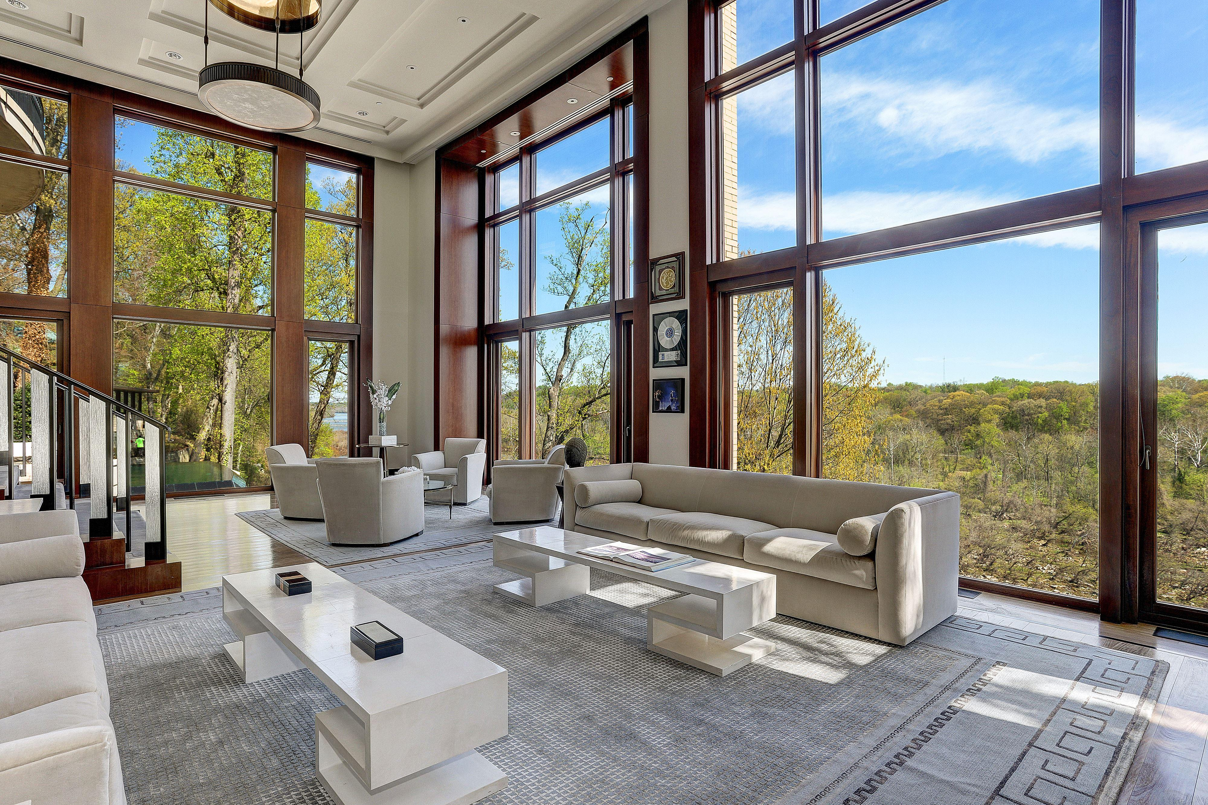 For $62.95 million, you could buy more than 1700 Tesla model 3's or almost 70,000 pairs of Christian Louboutin shoes. Or you can buy a 48,000+-square-foot mansion overlooking the Potomac River with nine bedrooms, 20 bathrooms, a garage that can accommodate over 30 cars and a guest house designed by Frank Lloyd Wright. (Image: Courtesy HomeVisit)