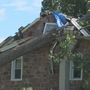 Howard family cleans up after tree crashes through roof during storm
