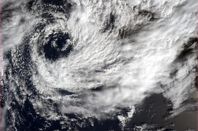 A small southern hemisphere cyclone spinning off the African coast. (Photo & Caption: Col. Chris Hadfield, NASA)