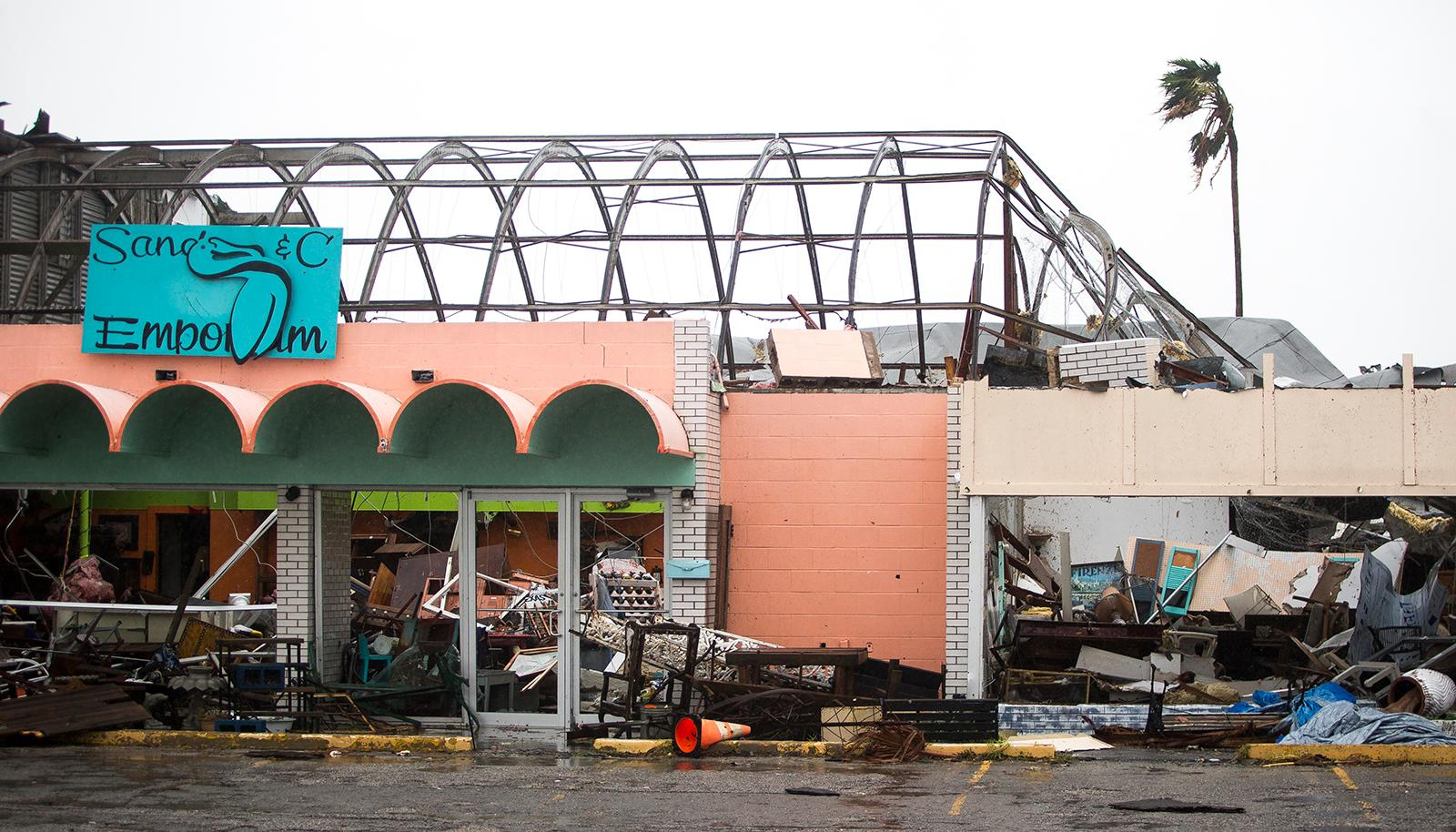 Stores remain destroyed after Hurricane Harvey ripped through Rockport, Texas, on Saturday, Aug. 26, 2017.  The fiercest hurricane to hit the U.S. in more than a decade spun across hundreds of miles of coastline where communities had prepared for life-threatening storm surges, walls of water rushing inland.  (Nick Wanger/Austin American-Statesman via AP)