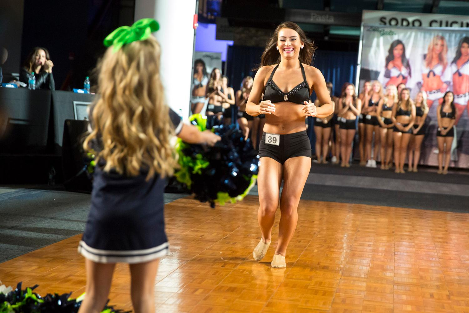 Welcome Michaela, a 2018 Sea Gal! Dancers performed a choreographed routine and spoke briefly about themselves. The entire evening was live broadcasted on the Seahawks website. (Sy Bean / Seattle Refined)