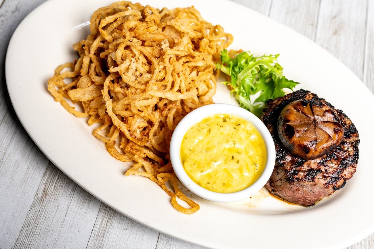 Filet Mignon: Eight ounce, center-cut medallion of beef, specially seasoned. Served with onion straws and Bearnaise sauce on the side / Image: Amy Elisabeth Spasoff // Published: 11.2.2018