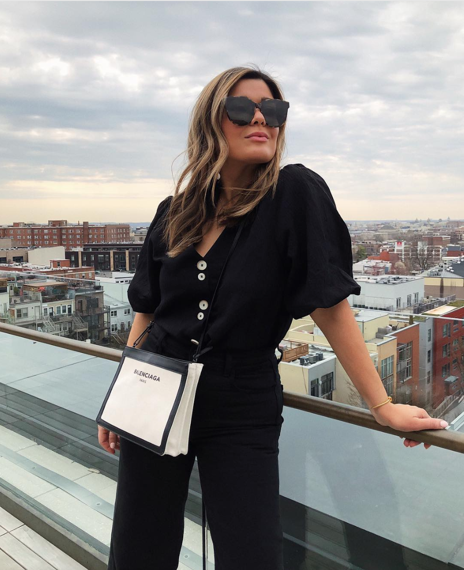 We know everyone's wearing brights, but if you want to stick to black, changing up the silhouette with an structured top is a good way to shake off the winter cobwebs.  (Image courtesy of @sara.azani)