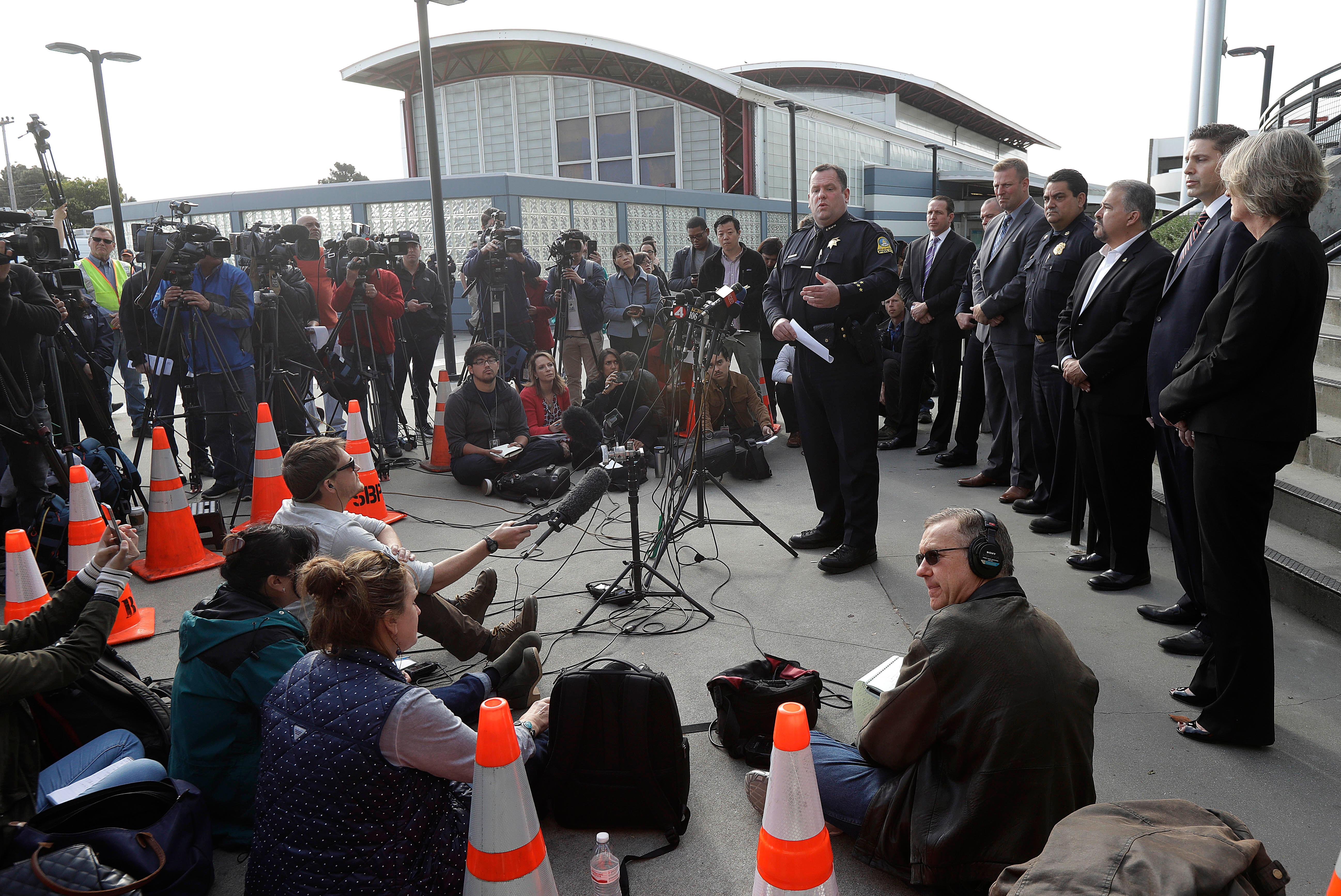 San Bruno Police Chief Ed Barberini, center right, speaks at a news conference in San Bruno, Calif., Wednesday, April 4, 2018. A woman suspected of shooting three people at YouTube headquarters before killing herself was furious with the company because it had stopped paying her for videos she posted on the platform, her father said Tuesday, April 3, 2018. (AP Photo/Jeff Chiu)
