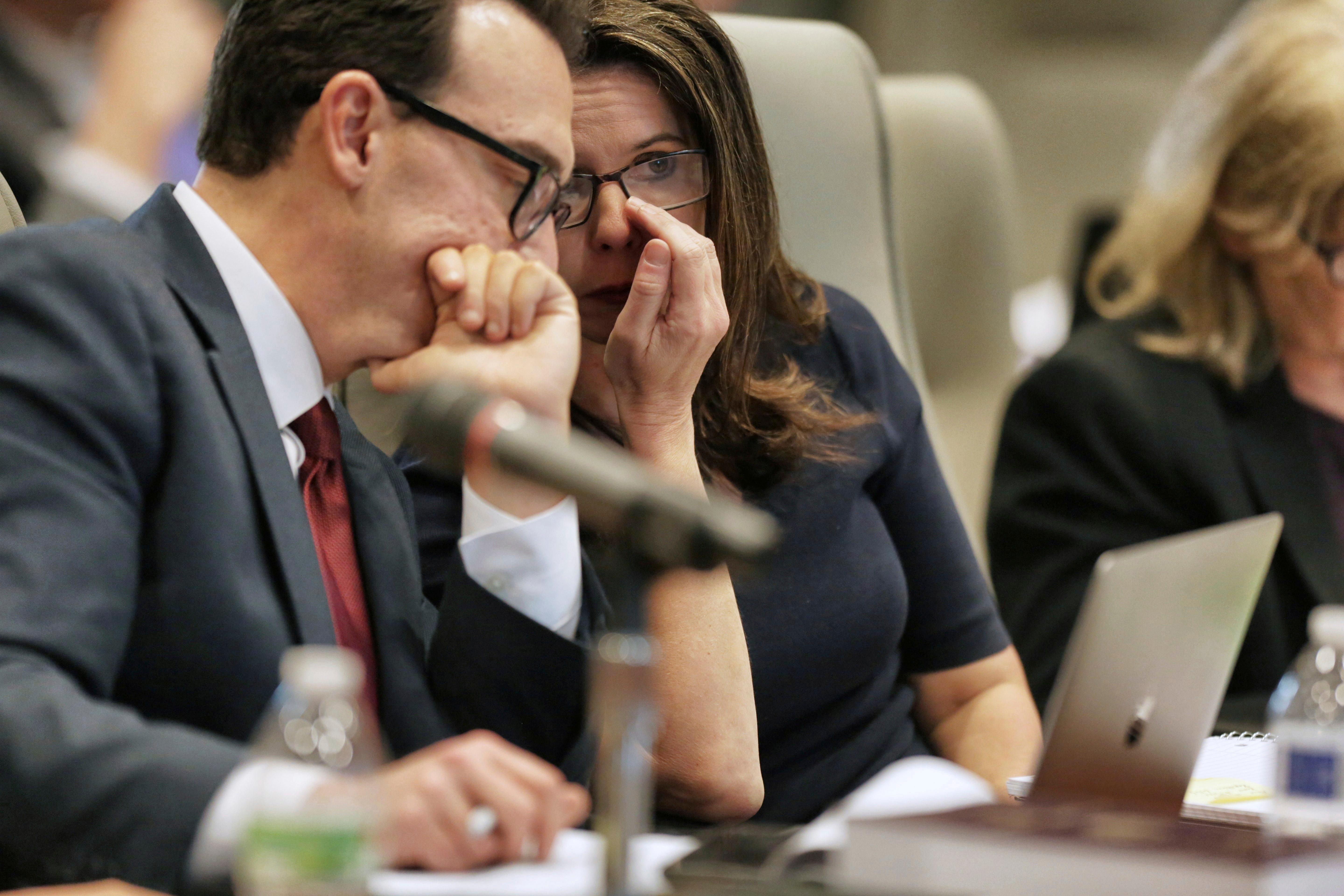 Executive Director of the Board of Elections Kim Strach, right, talks to general counsel Josh Lawson during a public evidentiary hearing on the 9th Congressional District investigation at the North Carolina State Bar in Raleigh, N.C., Monday, Feb. 18, 2019. (Juli Leonard/The News & Observer via AP, Pool)