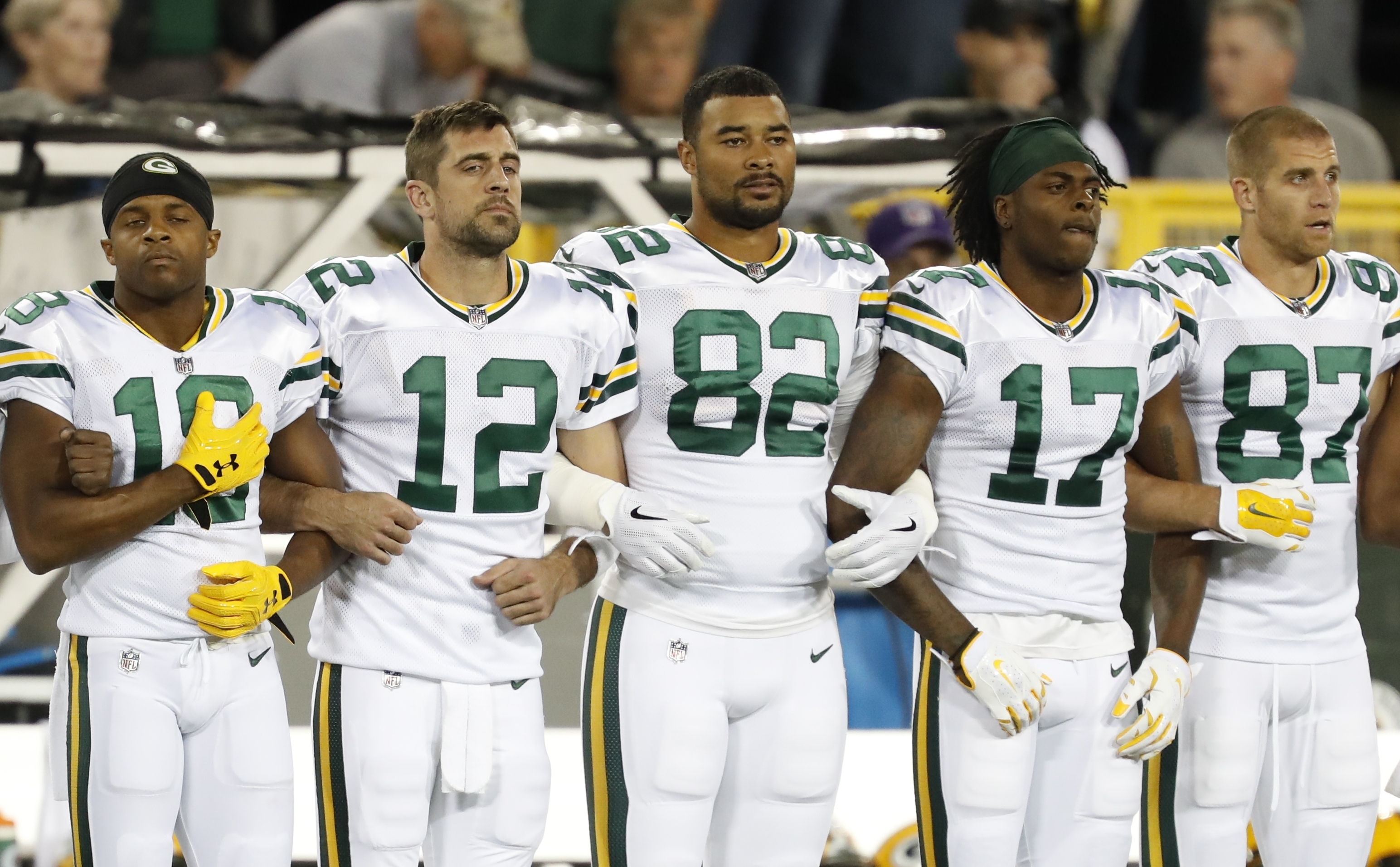 Green Bay Packers link arms during the national anthem before a game against the Chicago Bears Thursday, Sept. 28, 2017, in Green Bay. (AP Photo/Matt Ludtke)