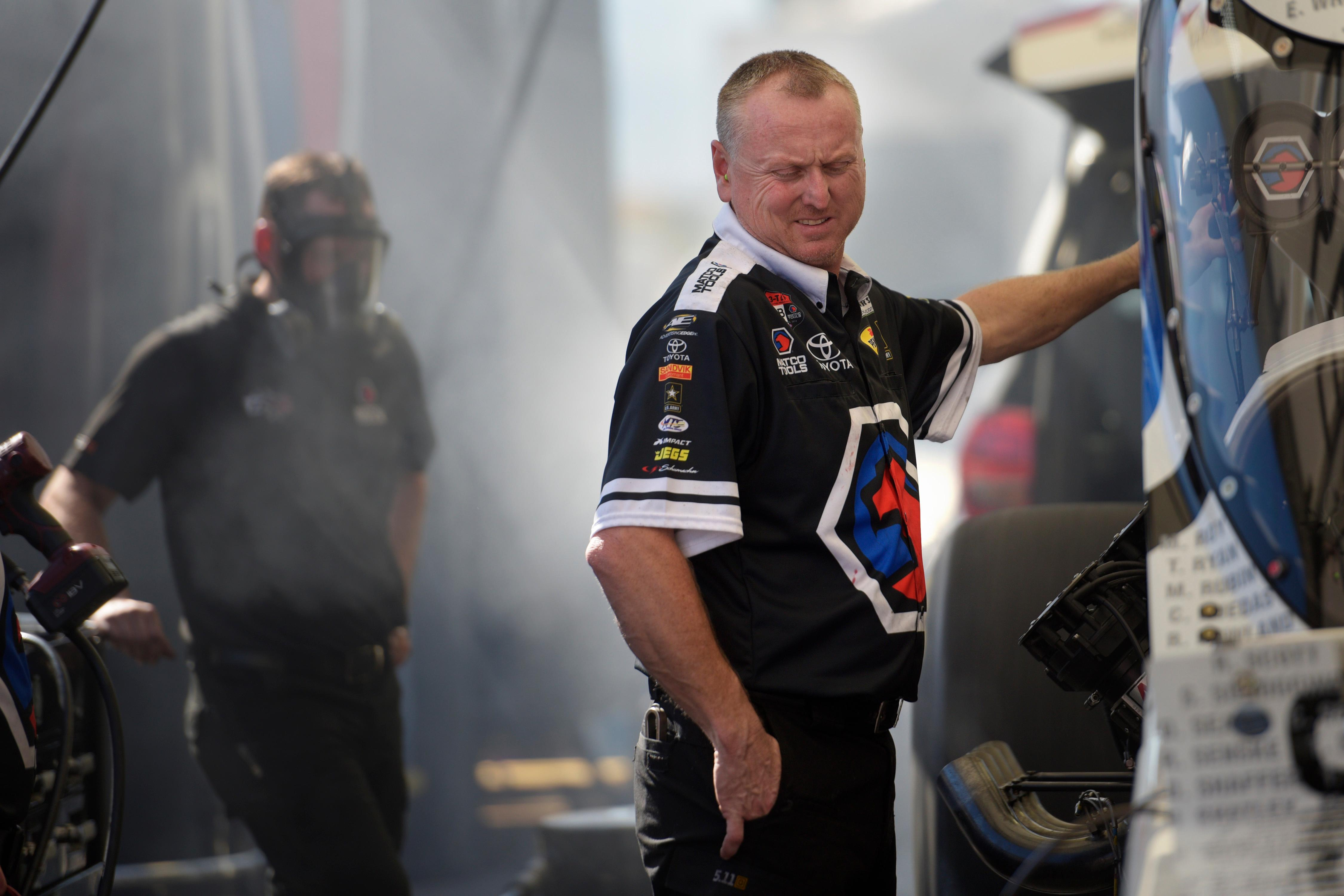 One of Top Fuel driver Antron Brown's crew members winces from nitro fumes while testing the car between runs during the NHRA DENSO Spark Plug Nationals at The Strip at the Las Vegas Motor Speedway Sunday, April 2, 2017. (Sam Morris/Las Vegas News Bureau)