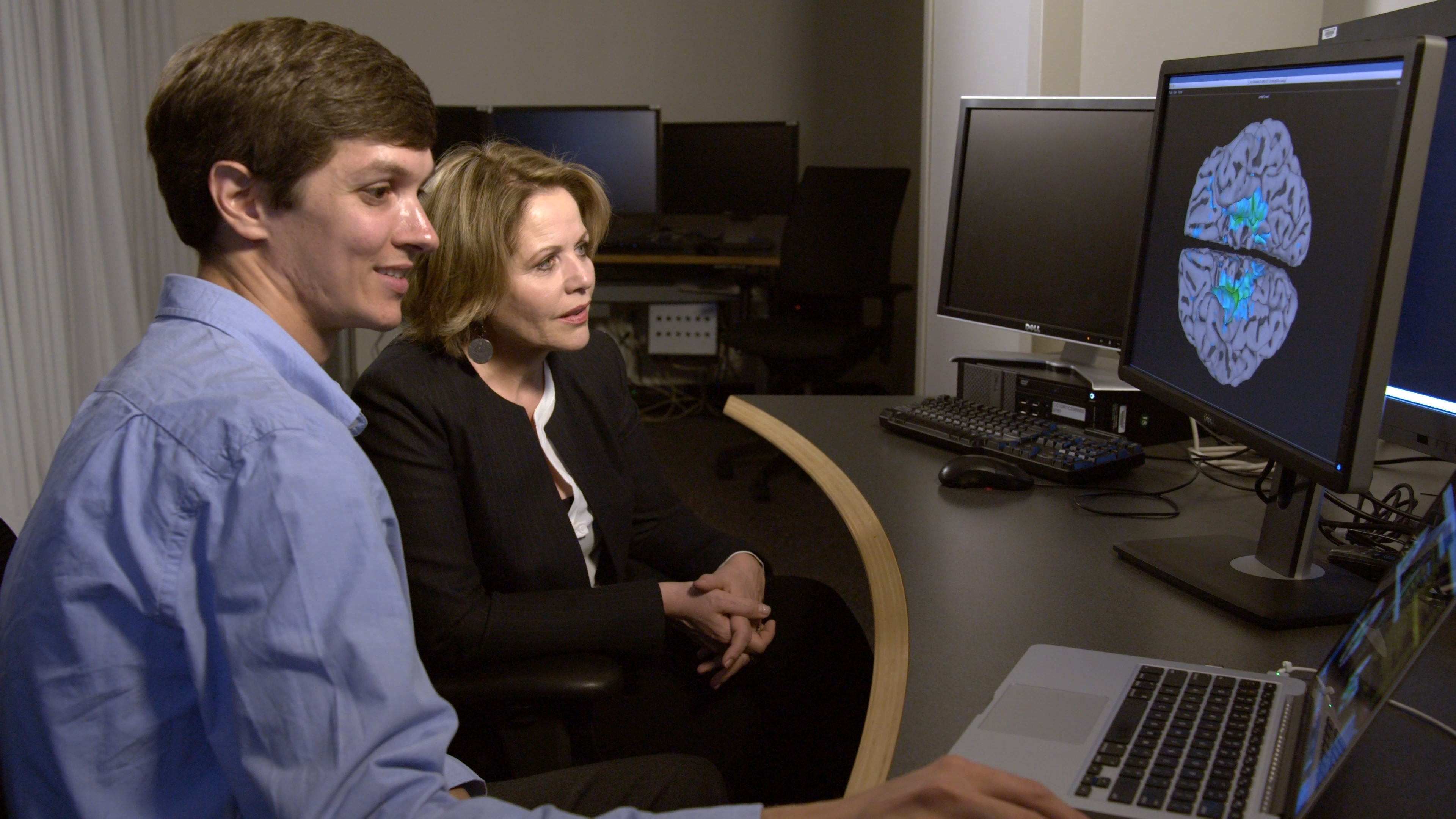 In this April 15, 2017 photo provided by the National Institutes of Health, singer Renee Fleming looks at a brain scan with NIH neuroscientist David Jangraw after singing in the MRI machine, at the National Institutes of Health in Bethesda, Md. (National Institutes of Health via AP)