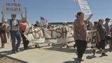 Thousands of protestors march to Tornillo to oppose housing immigrant children in tents